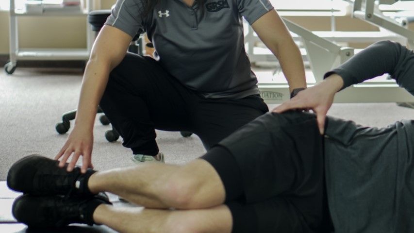 GRSM chiropractor demonstrating proper exercise techniques