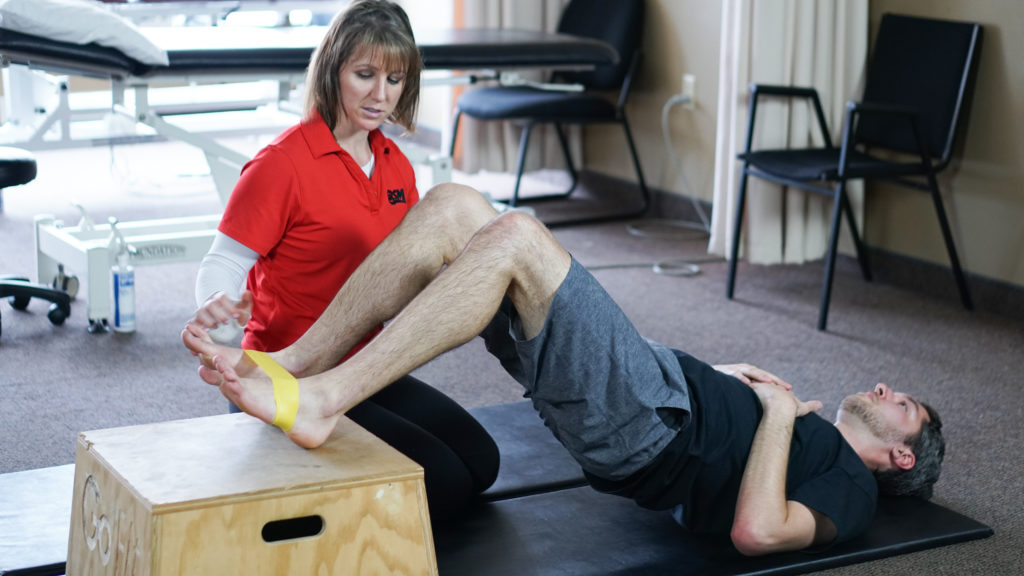 Physiotherapist GRSM kitchener demonstrating proper exercise form