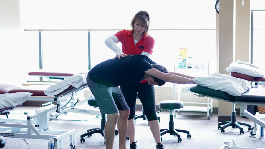 Physiotherapist GRSM kitchener demonstrating proper stretch form