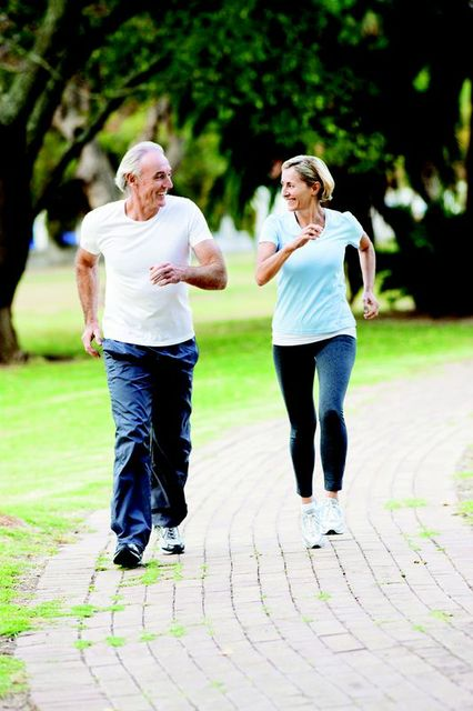Elderly Man and Woman Jogging