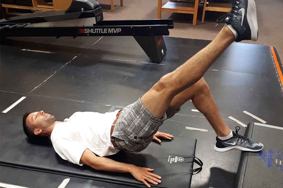 David physiotherapist demonstrates Single Leg Soleus Bridge