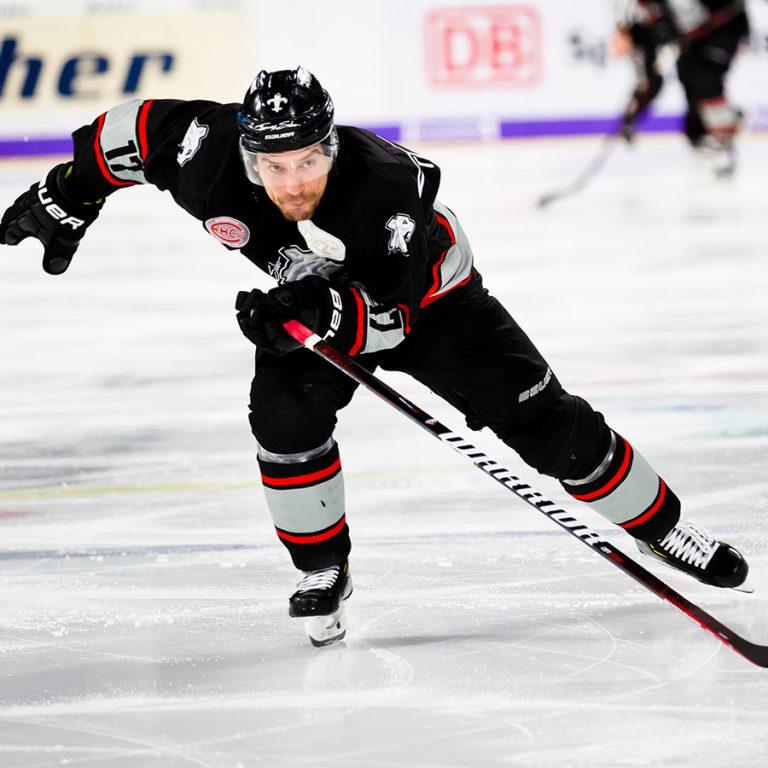 Hockey player skating on ice