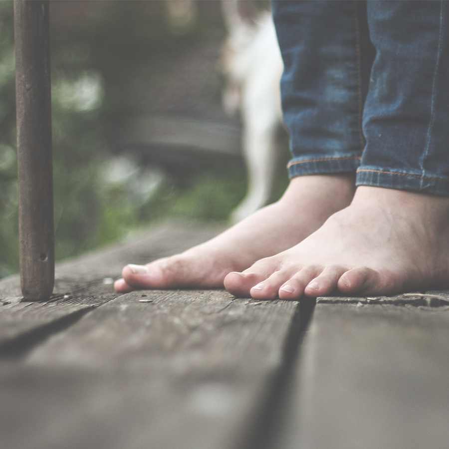 Feet on a deck