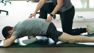 Client doing exercises with chiropractor