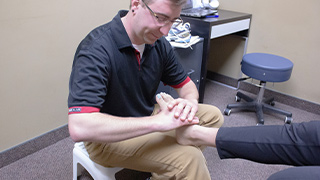 Pedorthist treating client foot