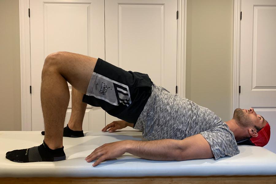 male doing bridge exercise