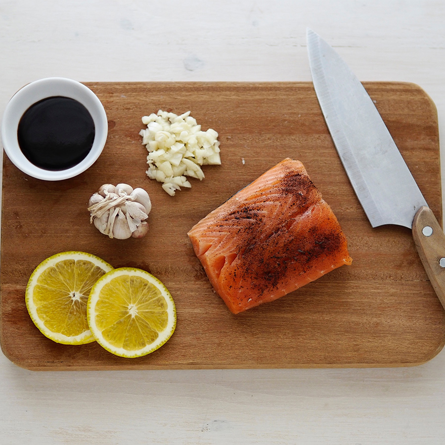 food and knife on cutting board