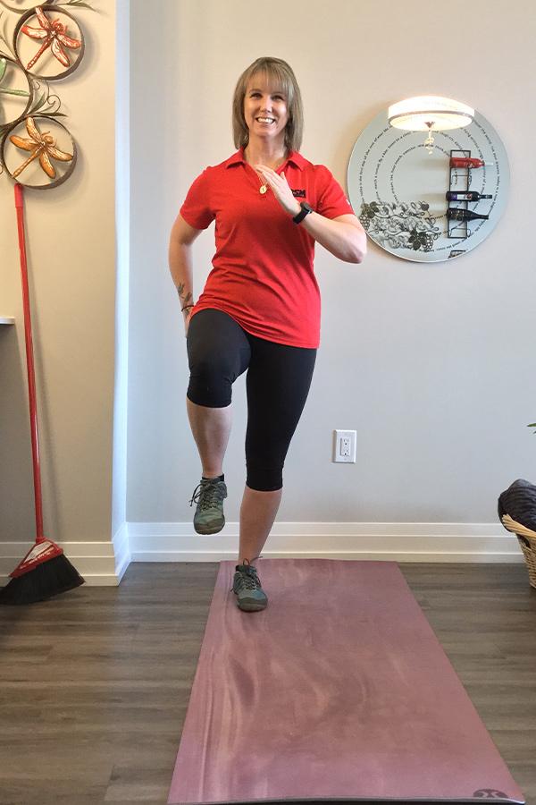 female demonstrating single leg stance exercise