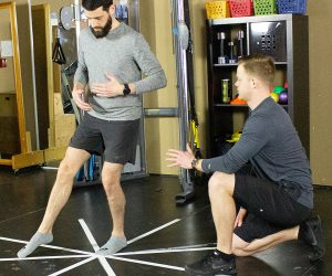 Blake physiotherapist demonstrates star balance exercise for sprained ankle rehab