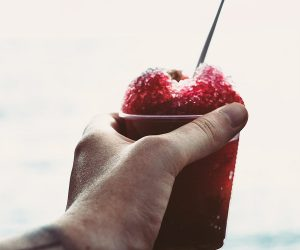 Hand holding red ice slushy